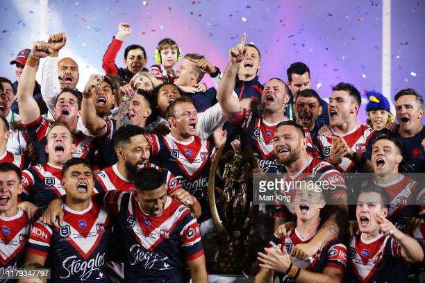 The Roosters celebrate victory on stage after the 2019 NRL Grand Final match between the Canberra Raiders and the Sydney Roosters at ANZ Stadium on...