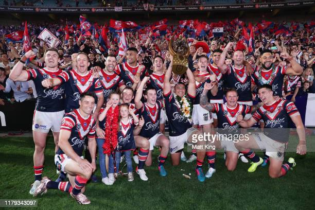 The Roosters celebrate victory with fans after the 2019 NRL Grand Final match between the Canberra Raiders and the Sydney Roosters at ANZ Stadium on...