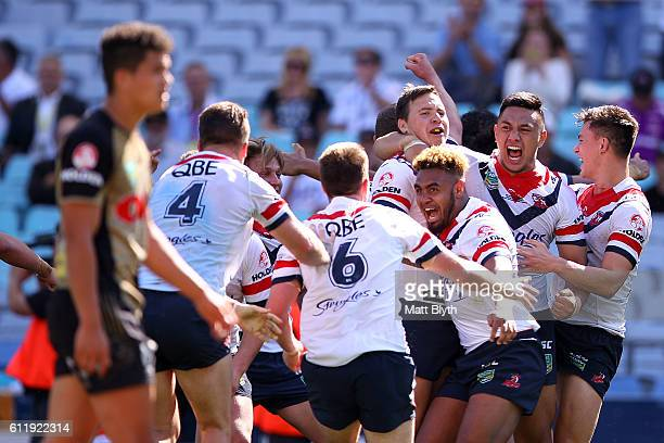 The Roosters celebrate winning the 2016 Holden Cup U20's Grand Final match between the Penrith Panthers and Sydney Roosters at ANZ Stadium on October...