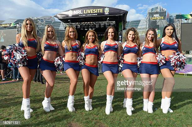 The Roosters cheerleaders pose during the NRL Grand Final fan day at Darling Harbour on October 3 2013 in Sydney Australia