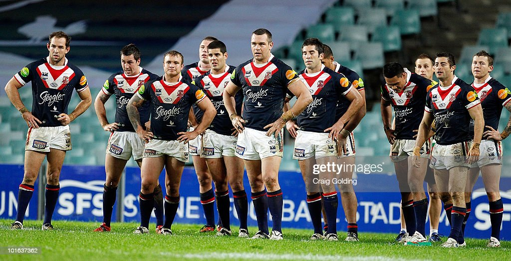 The Roosters stand dejected after a Sharks try during the round 13 NRL match between the Sydney Roosters and the Cronulla Sharks at Sydney Football Stadium on June 5, 2010 in Sydney, Australia.