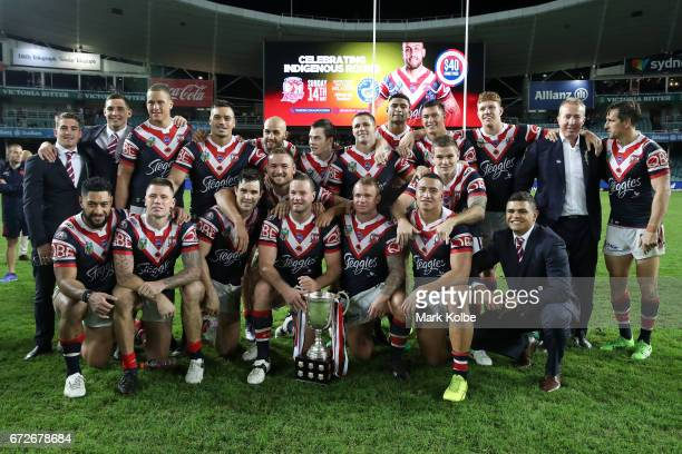 The Roosters team pose with the Anzac Day trophy after victory during the round eight NRL match between the Sydney Roosters and the St George...