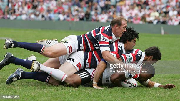 The Roosters' Wes Naiqama is tackled by three Roosters during the NRL Round 7 match between the Sydney Roosters and St George Illawarra Dragons at...