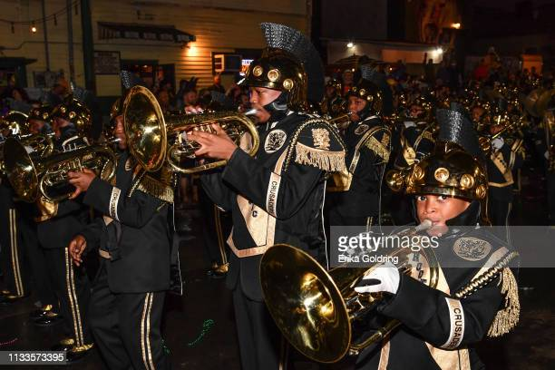 The Roots of Music Marching Crusaders Band participate in The Krewe of Bacchus parade on March 3, 2019 in New Orleans, Louisiana.