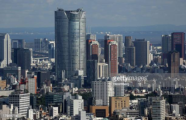 The Roppongi Hills Mori Tower operated by Mori Building Co center left stands in Tokyo Japan on Tuesday Sept 3 2013 Tokyo is the oddson favorite to...