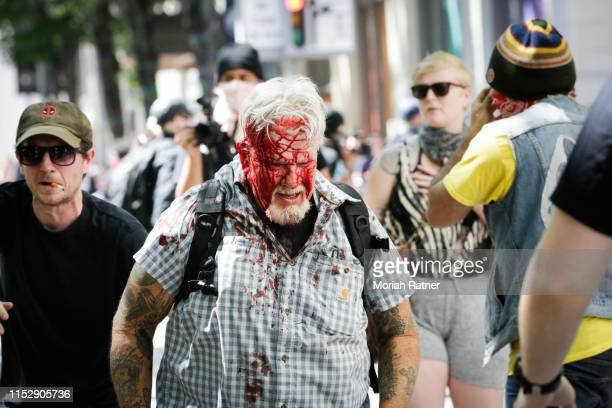 The Rose City Antifa brutally attacks an unidentified right aligning man at Pioneer Courthouse Square on June 29 2019 in Portland Oregon Several...
