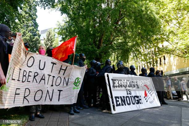 The Rose City Antifa prepare to march in opposition to members of HimToo and Proud Boys on June 29 2019 in Portland Oregon Several groups from the...