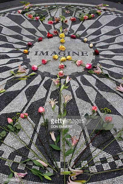 The rose covered mosaic of inlaid stones with the title of John Lennon's famous song 'Imagine' is seen in Central Park's Strawberry Fields 07...