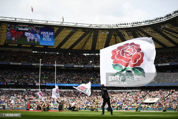 The rose flag is flown on the pitch ahead of the start of the international Test rugby union match between England and Wales at Twickenham Stadium in...