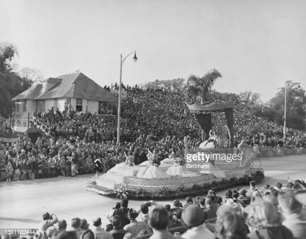 The Rose Queen's float as crowds of spectators watch during the annual parade marking the start of the Rose Bowl Game, on Colorado Boulevard in...