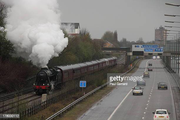 CONTENT] The Roses Express railtour races alongside the M602 between Eccles and Manchester with LMS Stanier Class 8F