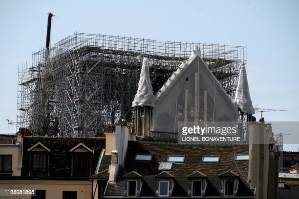 The Rosette of NotreDame de Paris Cathedral in Paris on April 22 is covered with protective material seven days after a fire devastated the cathedral...