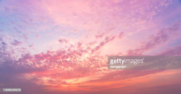 the rosy clouds at sunrise - sunrise dawn stock pictures, royalty-free photos & images