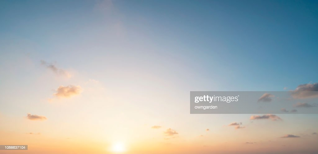 The rosy clouds at sunrise : Stock Photo