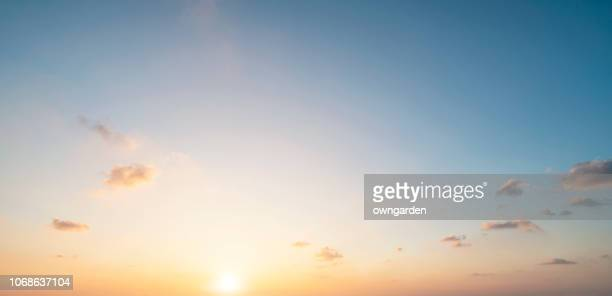 the rosy clouds at sunrise - zonlicht stockfoto's en -beelden