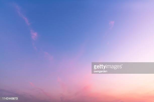 the rosy clouds at sunrise - zonsopgang stockfoto's en -beelden