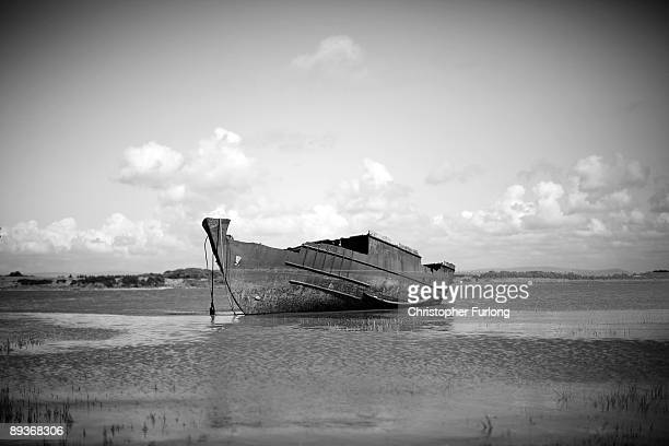 The rotting hulks of old boats decay in the sands of Fleetwood Marshes on July 27 2009 in Fleetwood England Seven boats have been rusting and rotting...