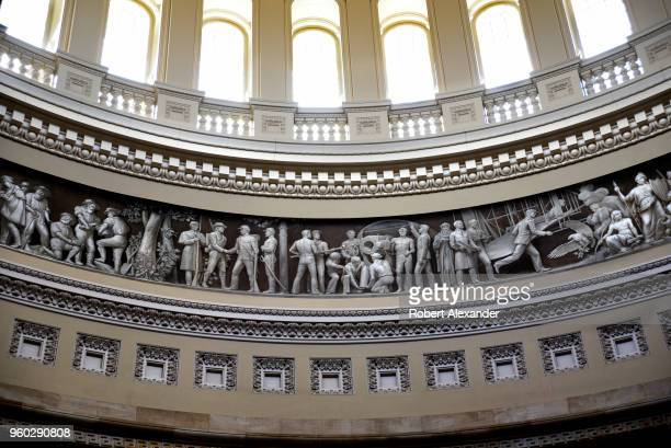 The Rotunda of the US Capitol in Washington DC features a frieze tracing America's history The fresco was painted by Constantino Brumidi in 1865