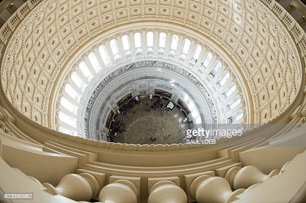 TOPSHOT The Rotunda of the US Capitol is seen from the newlyrestored Capitol Dome in Washington DC November 15 2016 The dome underwent a threeyear...