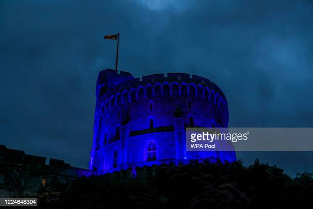 The Round Tower at Windsor Castle is illuminated blue on Friday evening as part of the NHS birthday celebrations on July 3, 2020 in Windsor, England....