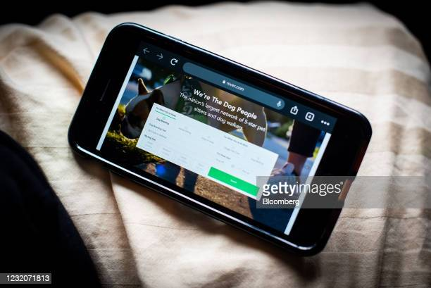 The Rover website on a smartphone arranged in Dobbs Ferry, New York, U.S., on Thursday, April 1, 2021. One of the signs that Covid-19's hold over...