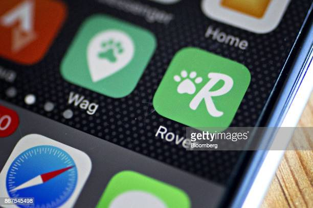 The Rovercom and Wag Labs Inc application icons are seen on an Apple Inc iPhone in an arranged photograph in Washington DC US on Friday Oct 27 2017...