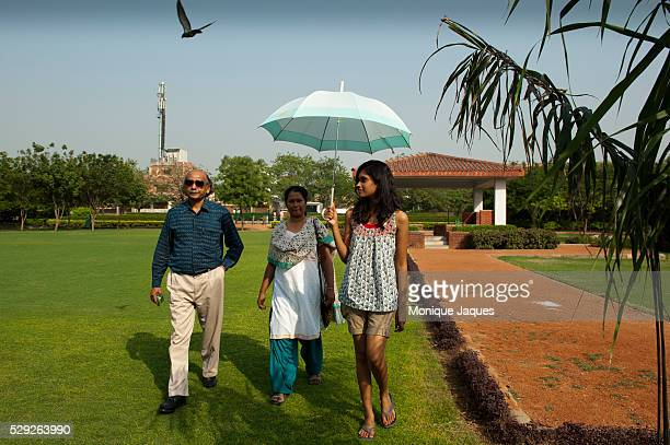 The Roy family on an afternoon park visit near their house Indian society traditionally favors many children and often boys though the Roy's note...