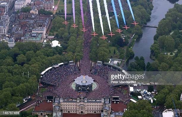The Royal Air Force Aerobatic Team fly in formation over Buckingham Palace as The Royal family stand on the balcony on June 5, 2012 in London,...