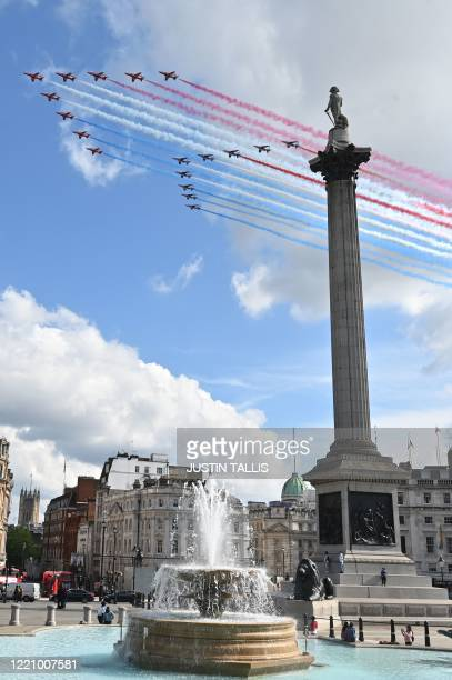 The Royal Air Force Aerobatic Team, the Red Arrows, and the French Air Force Aerobatic Team, La Patrouille de France, peform a fly-past over...