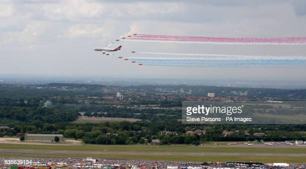 The Royal Air Force Aerobatic Team 'The Red Arrows' join a Virgin Atlantic 747-400 plane called 'Birthday Girl' to perform a fly past at the Biggin...