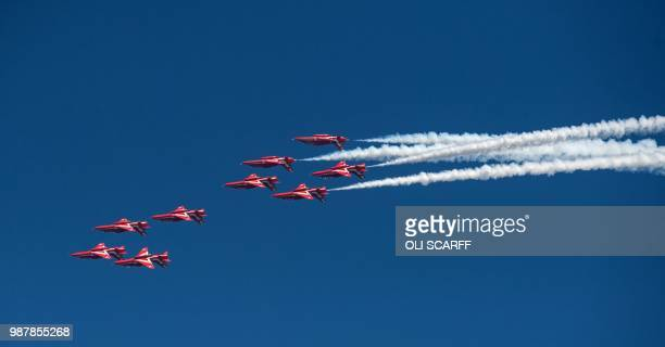 The Royal Air Force Aerobic Team the Red Arrows perform an aerobatic display during the national Armed Forces Day celebrations at Llandudno north...