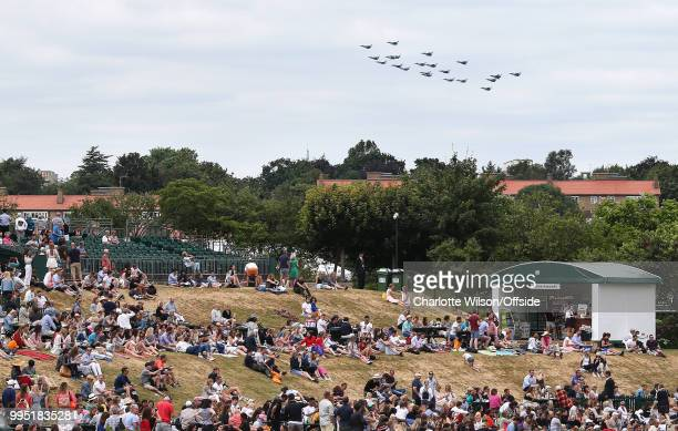 The Royal Air Force celebrate their centenary with a fly past planes can be seen flying over a sparsely crowded Henman's Hill at All England Lawn...