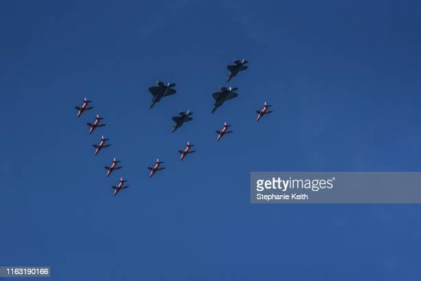 The Royal Air Force Red Arrows fly in front of the US Air Force's F35 Demo Team and the F22 Raptor Demo Team during a flyover the Hudson River on...