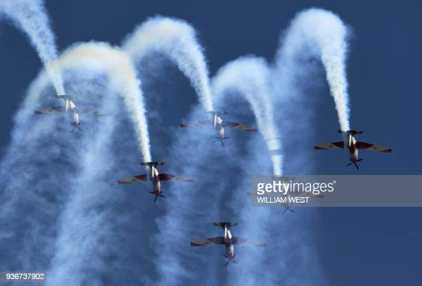 The Royal Australian Air Force Roulettes perform aerobatics in their Pilatus PC9/A aircraft ahead of the Formula One Australian Grand Prix in...