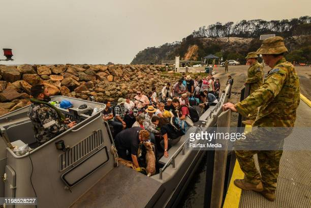 The Royal Australian Navy evacuates some 1000 residents and holidaymakers stranded by bushfires in the town of Mallacoota on the NSW South Coast...