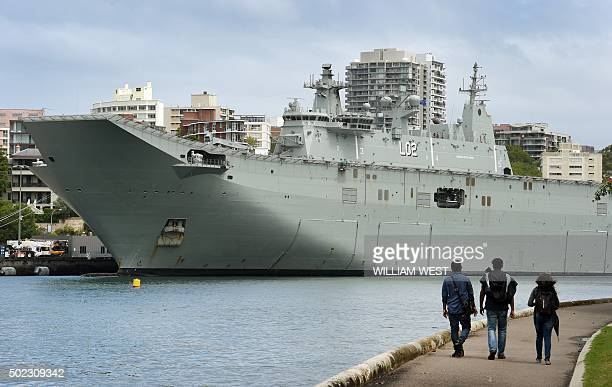 The Royal Australian Navy landing helicopter dock ship HMAS Canberra is seen moored at Sydney's Garden Island naval base after two men were arrested...