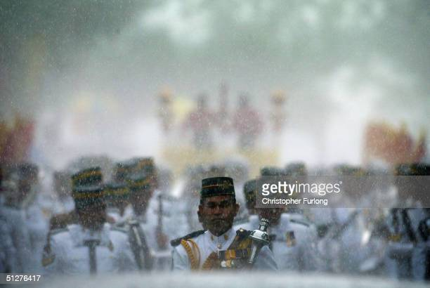 The royal band are drenched in the monsoon rain during the procession of Bruneian Crown Prince AlMuhtadee Billah Bolkiah and his bride Princess Sarah...