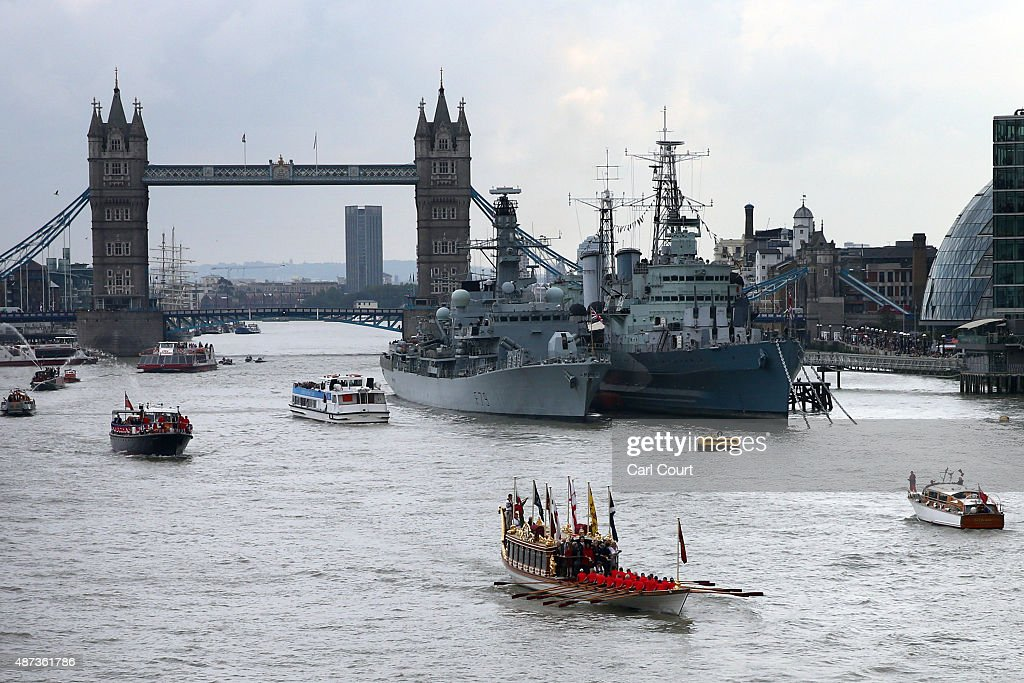 The Royal Barge Gloriana leads a procession along the River Thames near Tower Bridge and HMS Belfast to pay tribute to Queen Elizabeth II becoming Britain's longest reigning monarch on September 9, 2015 in London, England. The Queen will have served for 63 years and seven months - 23,226 days - by around 5.30pm today surpassing her great-grandmother Queen Victoria to become Britain's longest ever reigning monarch.