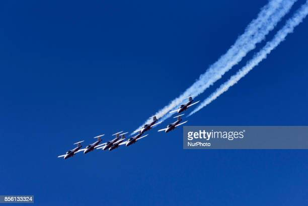 The Royal Canadian Air Force flight demonstration team the Snowbirds perform aerial maneuvers during the Breitling Huntington Beach Airshow in...