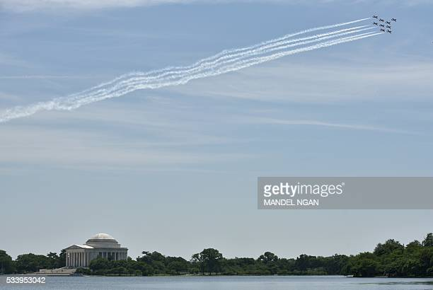The Royal Canadian Air Force Snowbirds aerobatics team perform a fly-over above the Jefferson Memorial on May 24, 2016 in Washington, DC. / AFP /...