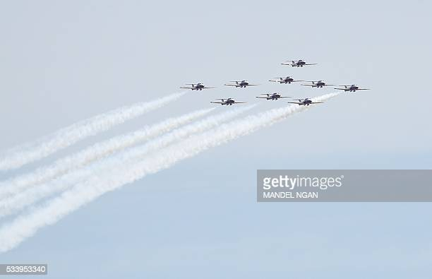 The Royal Canadian Air Force Snowbirds aerobatics team perform a flyover above the Jefferson Memorial on May 24 2016 in Washington DC / AFP / MANDEL...