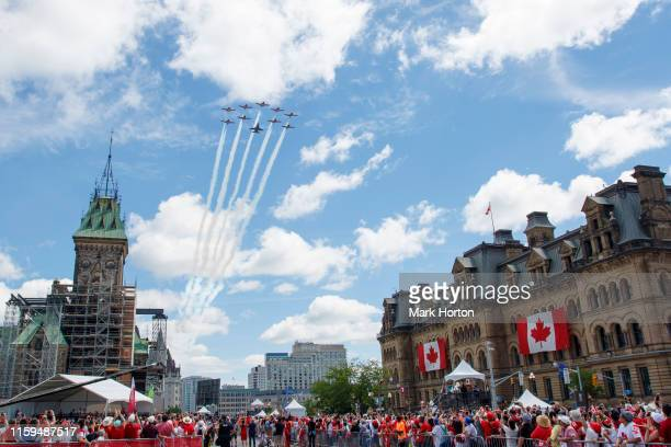 The Royal Canadian Air Force Snowbirds and a CF-18 perform a flyby during Canada Day ceremonies at Parliament Hill on July 01, 2019 in Ottawa, Canada.