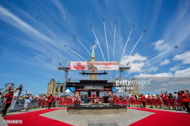 The Royal Canadian Air Force Snowbirds perform a flyby during Canada Day ceremonies at Parliament Hill on July 01, 2019 in Ottawa, Canada.