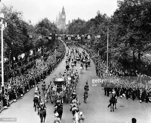 The royal carriage of Queen Elizabeth II passes along Victoria Embankment on its way to Westminster Abbey on June 02 during the ceremony of...