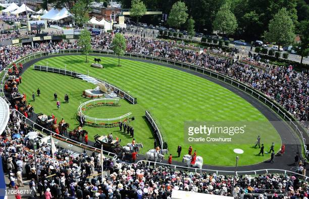 The Royal Carriage Procession makes it way around the Parade Ring during day two of Royal Ascot at Ascot Racecourse on June 19 2013 in Ascot England