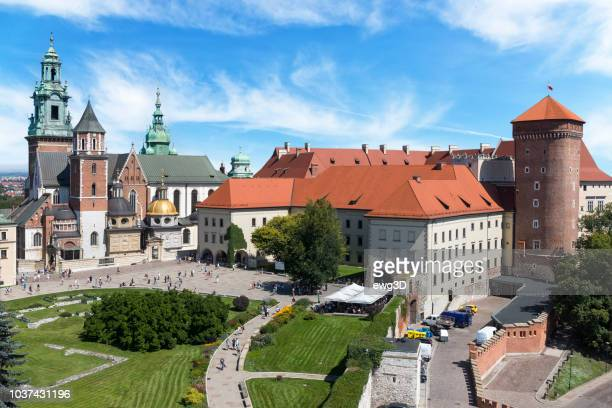 the royal castle on wawel hill in the city of krakow in poland - krakow stock pictures, royalty-free photos & images