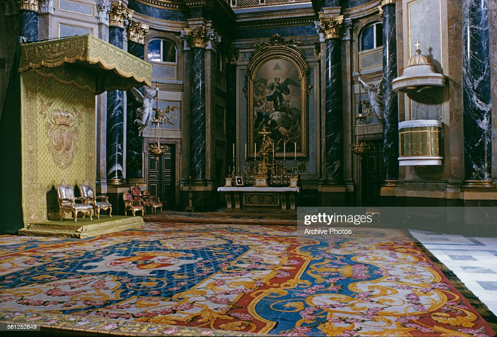 The Royal Chapel in the Royal Palace of Madrid, Spain, 1958. Above the High Altar is a painting of the Archangel Michael by Ramon Bayeu.