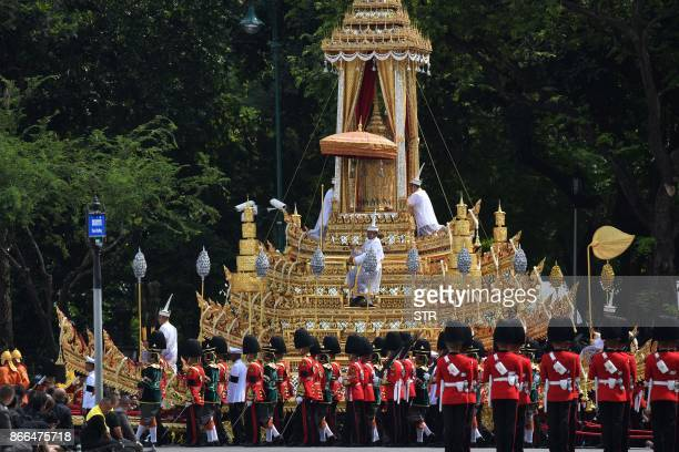 The Royal Chariot is seen during the funeral procession for the late Thai king Bhumibol Adulyadej in Bangkok on October 26 2017 A sea of blackclad...