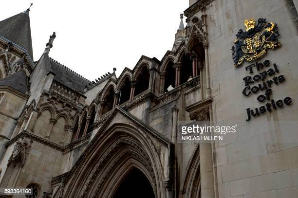 The Royal Coat of Arms and signage is pictured on an external wall of The Royal Courts of Justice on The Strand in central London on August 21, 2016....