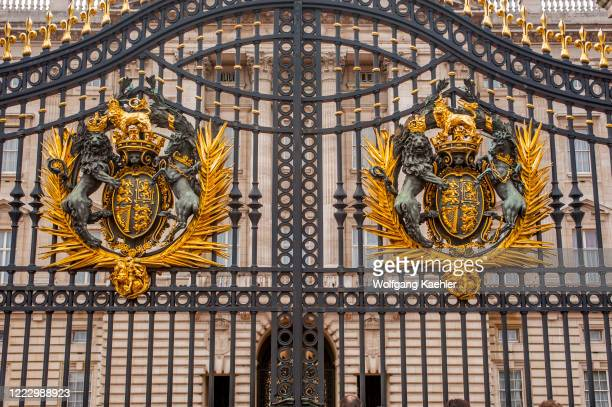 The Royal Coat of Arms on the wrought iron gates of the Buckingham Palace in London England Great Britain